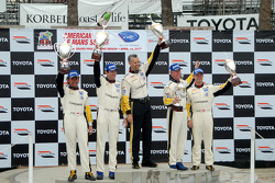 GT1 podium: class winners Oliver Gavin and Olivier Beretta, second place Johnny O'Connell and Jan Magnussen