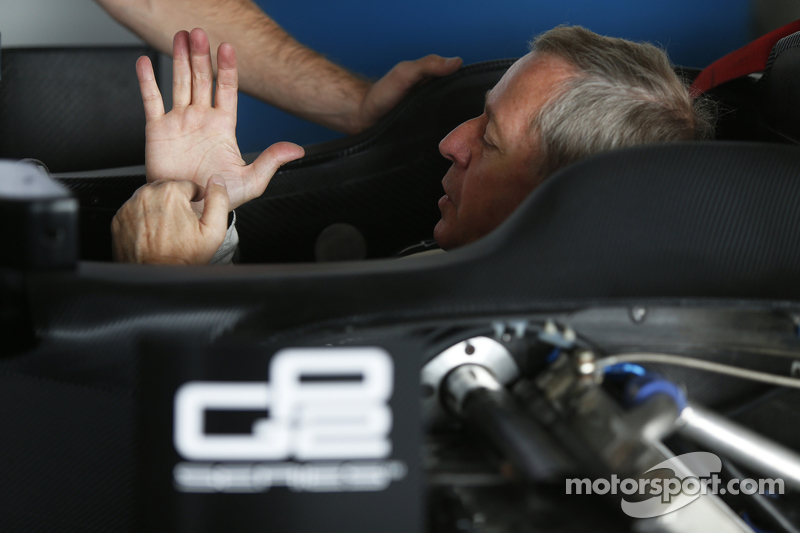 Martin Brundle has a seat fitting for a  demonstration run of a GP2 car bersama 18 inch Pirelli tyres