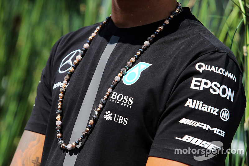 The necklace worn by Lewis Hamilton, Mercedes AMG F1
