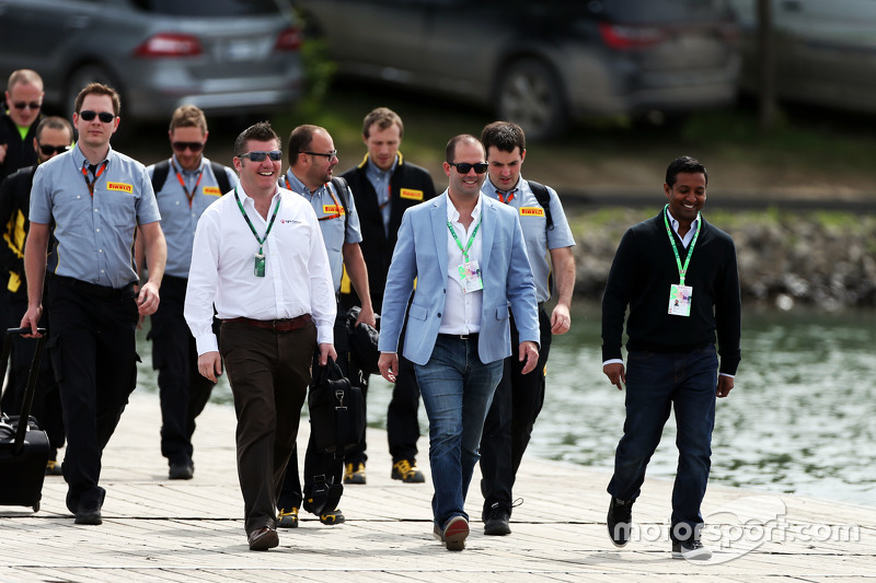Delegates arrive at the track