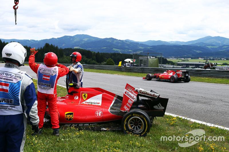 Sebastian Vettel, Ferrari SF15-T passes the damaged Ferrari SF15-T of team mate Kimi Raikkonen, Ferr