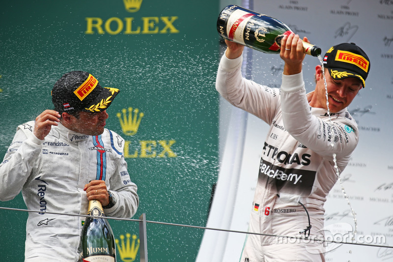 Race winner Nico Rosberg, Mercedes AMG F1 celebrates with the champagne with Felipe Massa, Williams, on the podium