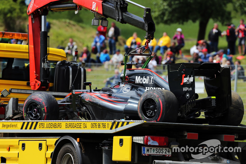 The McLaren MP4-30 of race retiree Fernando Alonso, McLaren is recovered back to the pits on the back of a truck