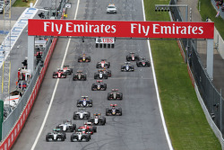 Nico Rosberg, Mercedes AMG F1 W06 and team mate Lewis Hamilton, Mercedes AMG F1 W06 battle for the lead at the start of the race