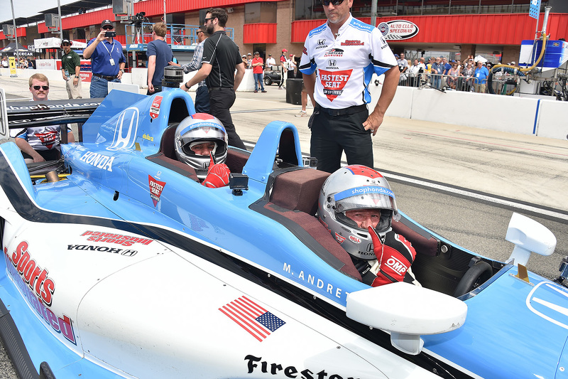 Jay Leno and Mario Andretti in the IndyCar two-seater