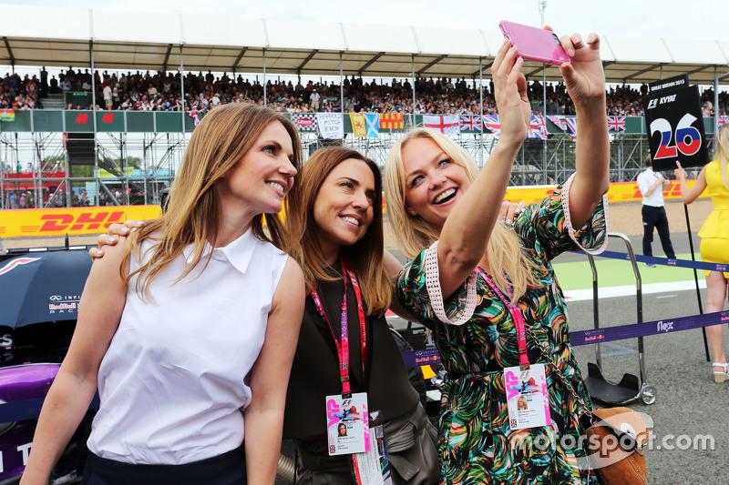 Former Spice Girls Geri Halliwell, Singe; Melanie Chisholm, Singer; and Emma Bunton, Singer on the grid