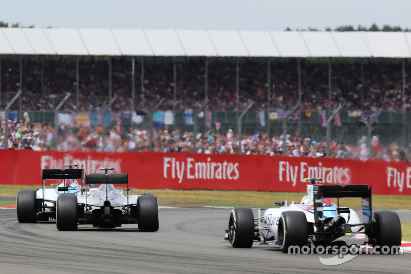 Felipe Massa, Williams FW37 leads Lewis Hamilton, Mercedes AMG F1 W06 and team mate Valtteri Bottas, Williams FW37