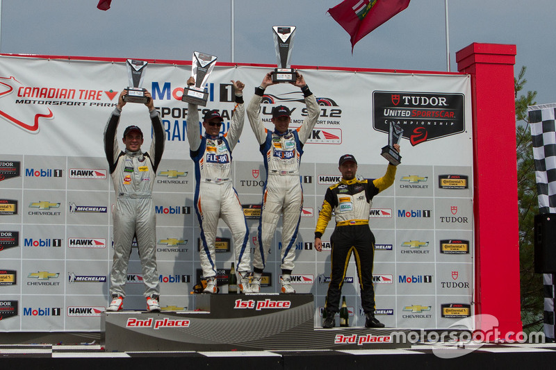 PC Podium: Race winner #54 CORE autosport Oreca FLM09: Jon Bennett, Colin Braun, second place #16 BA