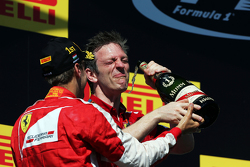 (L to R): Race winner Sebastian Vettel, Ferrari and James Allison, Ferrari Chassis Technical Director celebrate on the podium