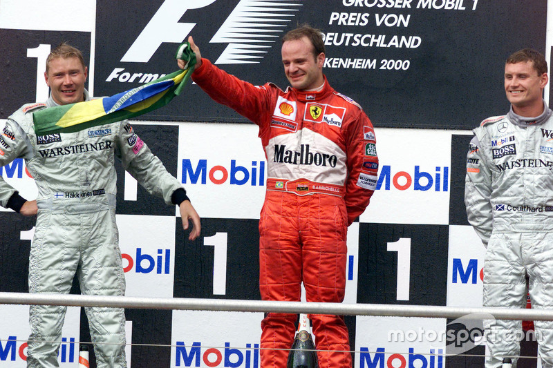 Podium: second place Mika Hakkinen, McLaren and winner Rubens Barrichello, Ferrari and third place David Coulthard, McLaren