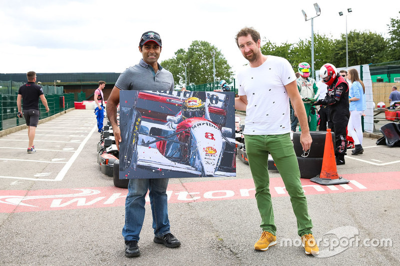 Karun Chandhok and Paul Oz with a painting of Ayrton Senna