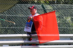 A marshal with a red flag