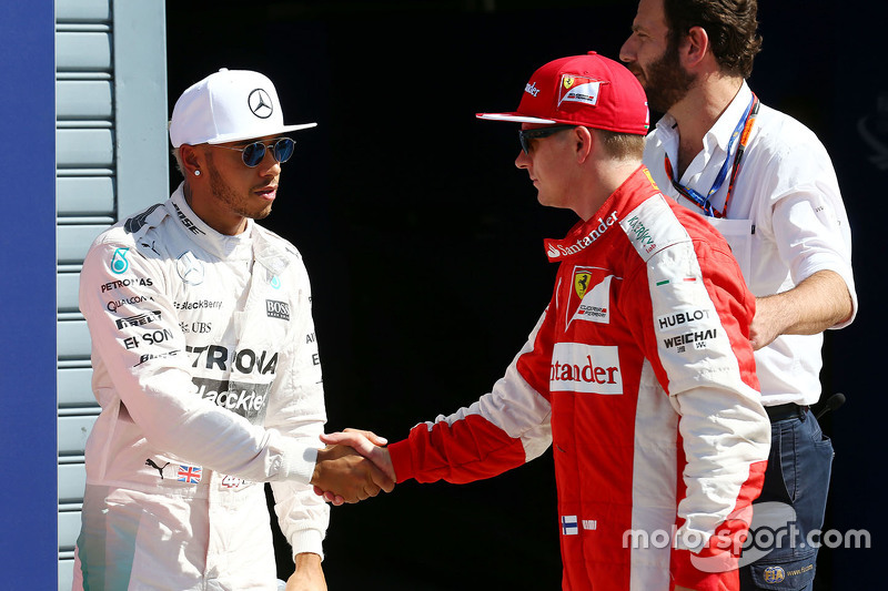 Lewis Hamilton, Mercedes AMG F1 celebrates his pole position in parc ferme with second placed Kimi Raikkonen, Ferrari