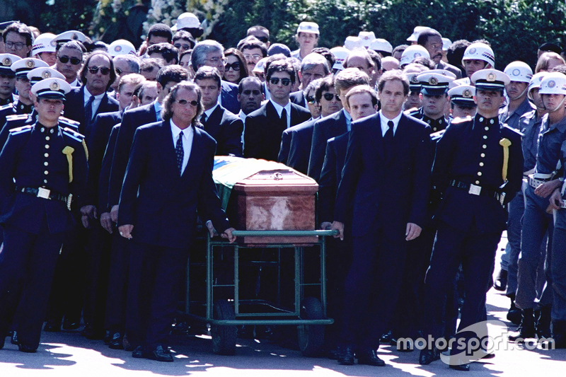 Emerson Fittipaldi, Jackie Stewart, Johnny Herbert, Derek Warwick, Gerhard Berger, Rubens Barrichello, Thierry Boutsen, Alain Prost and Damon Hill help lead the casket of Ayrton Senna during the funeral procession