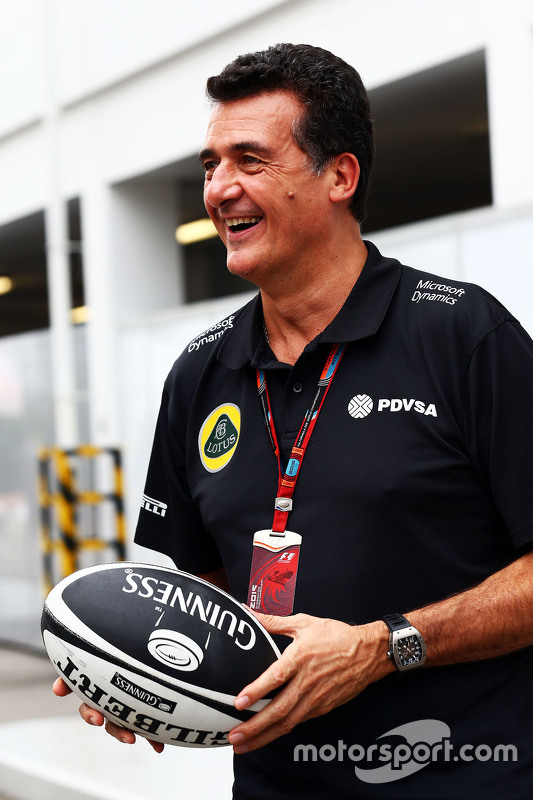 Federico Gastaldi, Lotus F1 Team Deputy Team Principal with a rugby ball