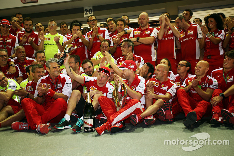Race winner Sebastian Vettel, Ferrari and third placed Kimi Raikkonen, Ferrari celebrate with the te