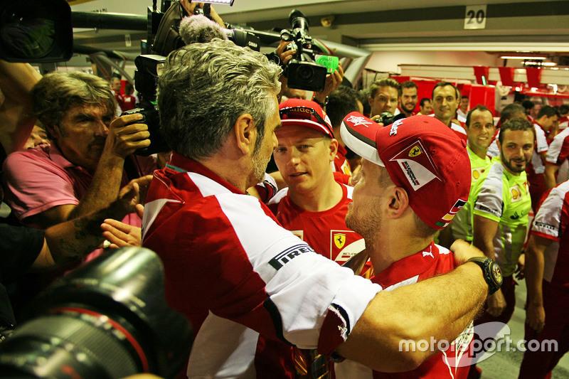 Race winner Sebastian Vettel, Ferrari celebrates with Maurizio Arrivabene, Ferrari Team Principal and team mate Kimi Raikkonen, Ferrari