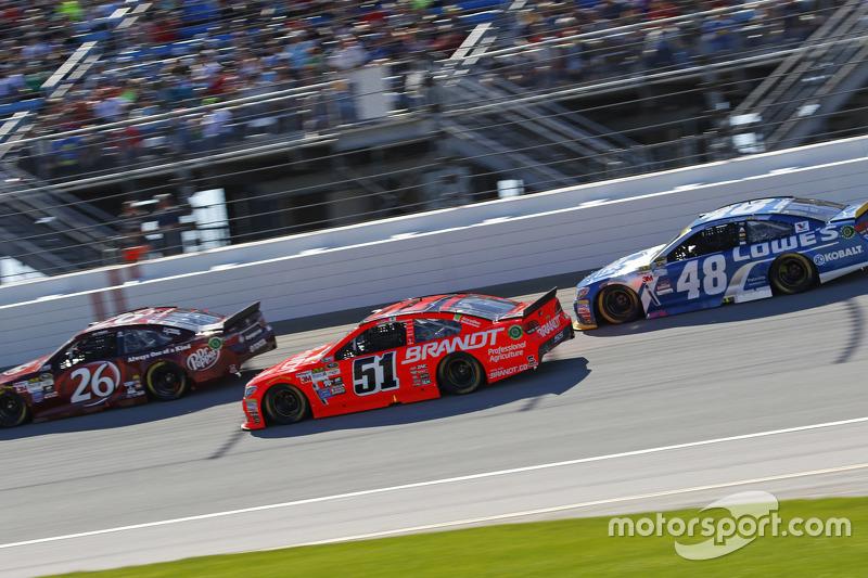 J.J. Yeley, BK Racing Toyota; Justin Allgaier, HScott Motorsports Chevrolet; Jimmie Johnson, Hendrick Motorsports Chevrolet