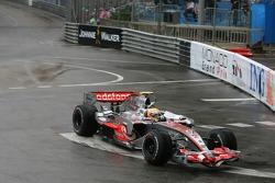 Lewis Hamilton, McLaren Mercedes, MP4-22, takes a different route around the circuit