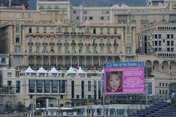 An appeal for information to find missing British girl Madeleine McCann is displayed on the screens at the circuit