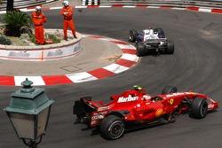 Nick Heidfeld, BMW Sauber F1 Team, F1.07 and Kimi Raikkonen, Scuderia Ferrari, F2007