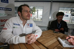 Jacques Villeneuve talks with member of the media