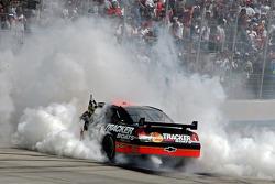 Race winner Martin Truex Jr. does a burnout