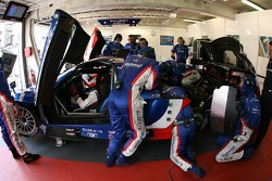 Nicolas Prost sits in the car while Team Oreca are at work