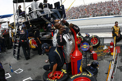 Brian Vickers gasman changes the nozzle on the gas can after a pit stop