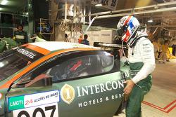 Peter Kox hands the Aston Martin over to Johnny Herbert