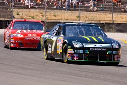 Robby Gordon leads the race from Dale Earnhardt Jr.