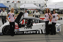 Playboy girls pose with the sponsored car