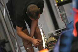 A Racing Engineering team member works on the car ready for the start of the weekend