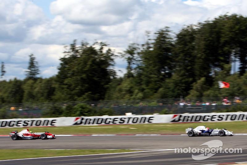 Robert Kubica, BMW Sauber F1 Team; Ralf Schumacher, Toyota Racing