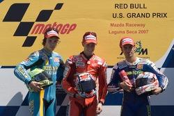 Podium: race winner Casey Stoner with Chris Vermeulen and Marco Melandri