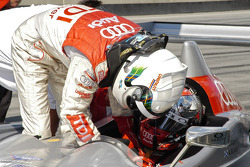 Allan McNish helps buckle in Rinaldo Capello