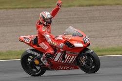 Race winner Loris Capirossi celebrates