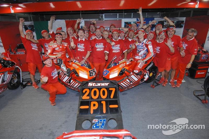 Celebrations at Ducati: 2007 MotoGP champion Casey Stoner and race winner Loris Capirossi celebrate