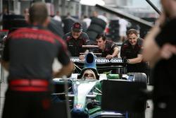 Murray Walker, Helps push the Honda Formula 1 car during pit stop practice