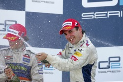Timo Glock celebrates winning the 2007 GP2 Series title on the podium with Javier Villa
