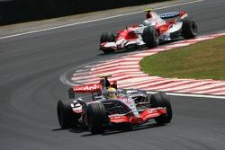 Lewis Hamilton, McLaren Mercedes, MP4-22 leads Jarno Trulli, Toyota Racing, TF107