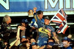 1995 Formula One World Champion Michael Schumacher celebrates with his team
