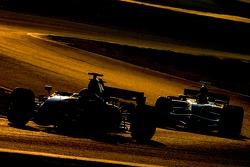 Kimi Raikkonen, Scuderia Ferrari, F2007 and Mark Webber, Red Bull Racing, RB3