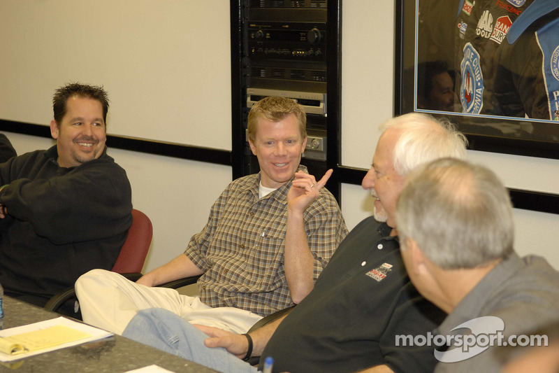 Physical Therapist Robert Ortmayer makes a point during a meeting at John Force Racing, Inc., with
