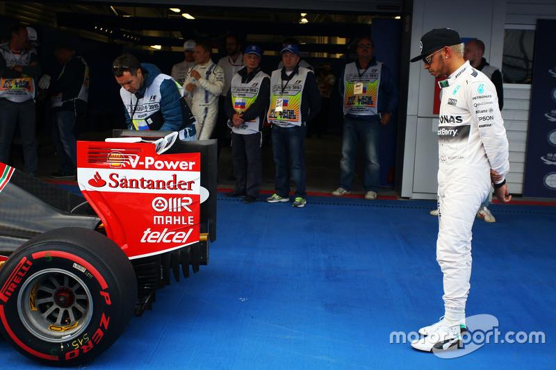 Lewis Hamilton, Mercedes AMG F1 W06 looks at the Ferrari SF15-T of Sebastian Vettel, Ferrari in parc ferme
