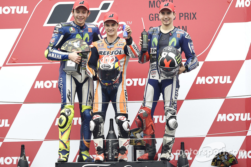 Podium: race winner Dani Pedrosa, Repsol Honda Team, second place Valentino Rossi, Yamaha Factory Racing, third place Jorge Lorenzo, Yamaha Factory Racing