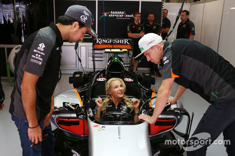 (L to R): Sergio Perez, Sahara Force India F1 with Darya Klishina, Long Jump Athlete and Nico Hulkenberg, Sahara Force India F1