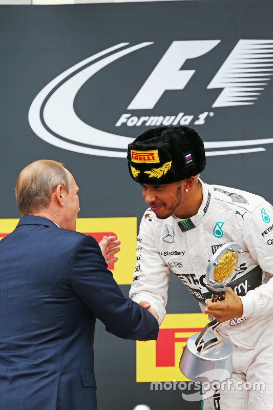 Race winner Lewis Hamilton, Mercedes AMG F1 celebrates on the podium with Vladimir Putin, Russian Federation President