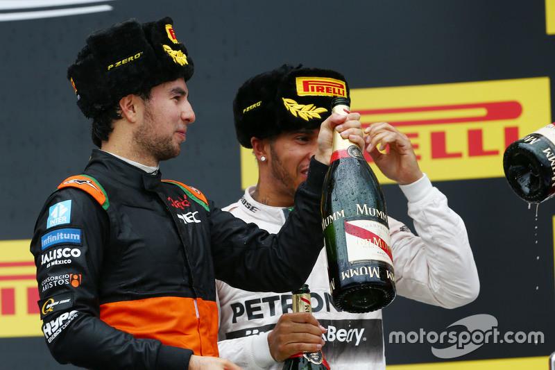 (L to R): Sergio Perez, Sahara Force India F1 celebrates his third position on the podium with race winner Lewis Hamilton, Mercedes AMG F1