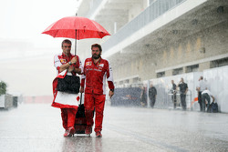 (L to R): Maurizio Arrivabene, Ferrari Team Principal with Gino Rosato, Ferrari in a wet and rainy paddock